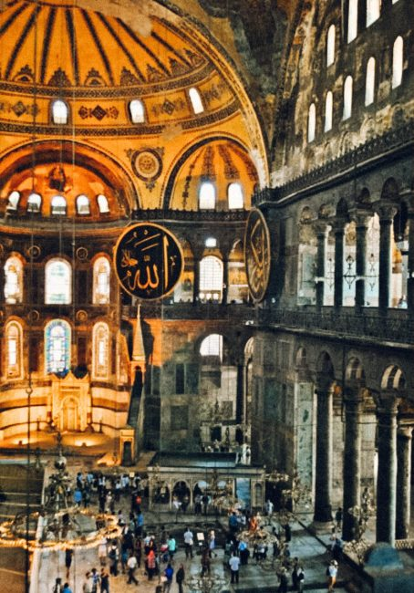 Hagia sophia a wonder of the ancient world pineappleislands the hagia sophias round wooden frames depics the names of allah and the prophet muhammad in arabic calligraphy the low hanging chandeliers from the domed aloadofball Images